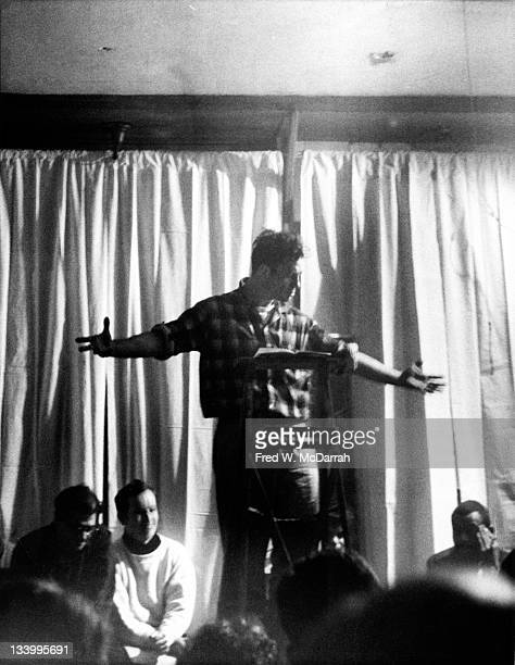 American author Jack Kerouac gestures expansively as he reads poetry at the Artist's Studio New York New York February 15 1959