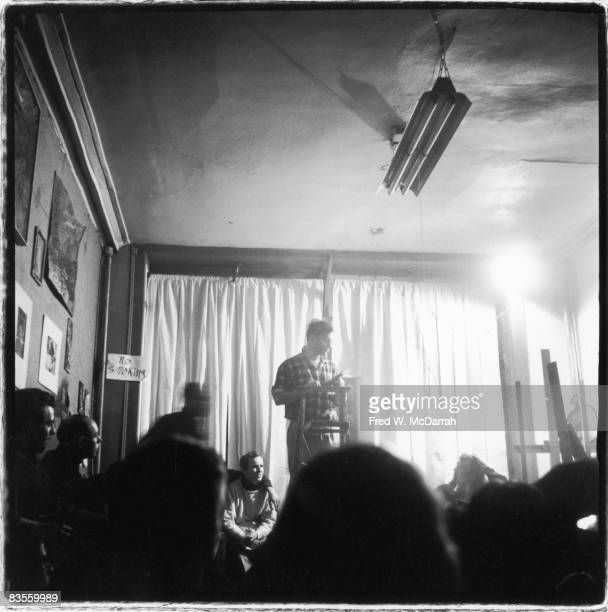 American author Jack Kerouac reads poetry from a podium at the Artist's Studio New York New York February 15 1959