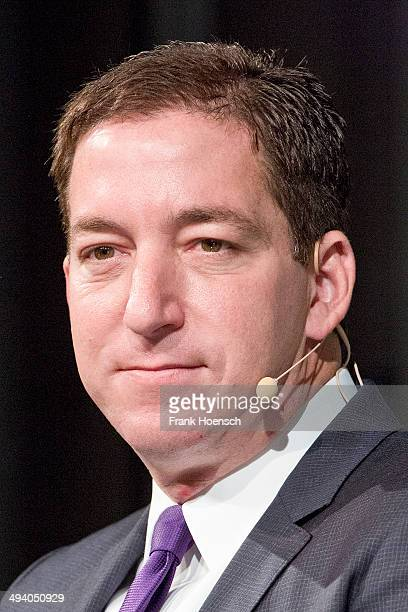 American author, journalist and lawyer Glenn Greenwald speaks during the presentation of his book 'Die globale Ueberwachung' at the Deutsches Theater...