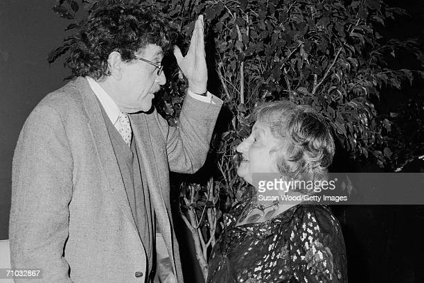 American author Kurt Vonnegut gestures with his hand as he talks to feminist author and social activist Betty Friedan during Friedan's 65th birthday...