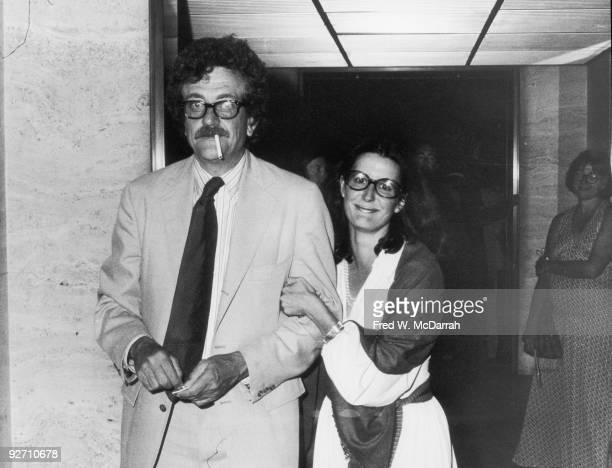 American author Kurt Vonnegut Jr. Lights a cigarette as he poses with his girlfriend and later wife, photographer Jill Krementz, September 16, 1973.