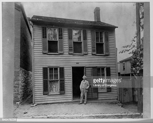 American author Mark Twain stands in front of his home in Hannibal Missouri in 1902