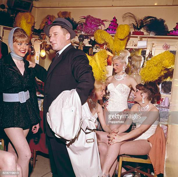 American author Mickey Spillane pictured meeting various show girls backstage in their dressing room during the shooting of the film The Girl Hunters...