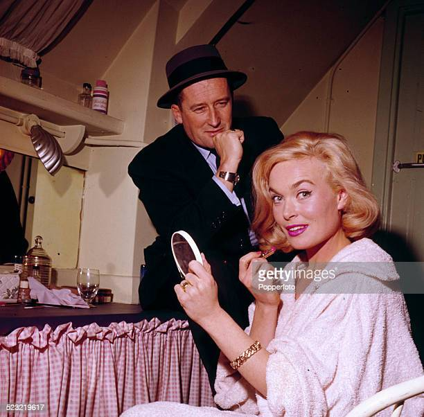 American author Mickey Spillane pictured with actress Shirley Eaton in a dressing room scene from the Mike Hammer film The Girl Hunters 1963