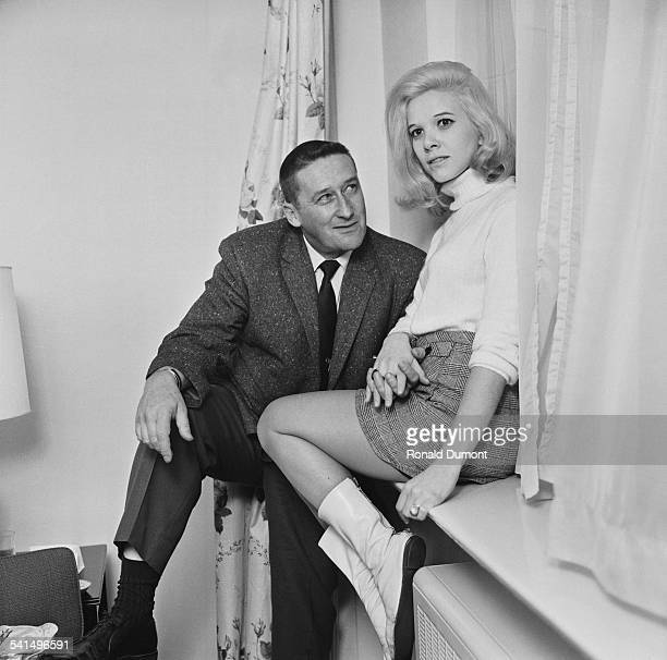 American author Mickey Spillane with his wife American singer Sherri Malinou in London 11th April 1967