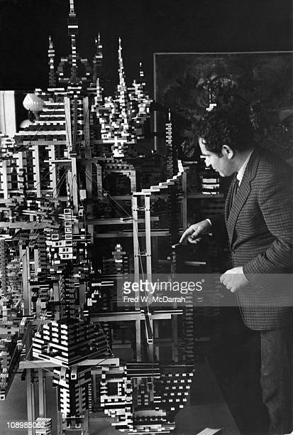 American author Norman Mailer points out features of a massive city built from Legobrand building blocks in his home New York New York February 14...