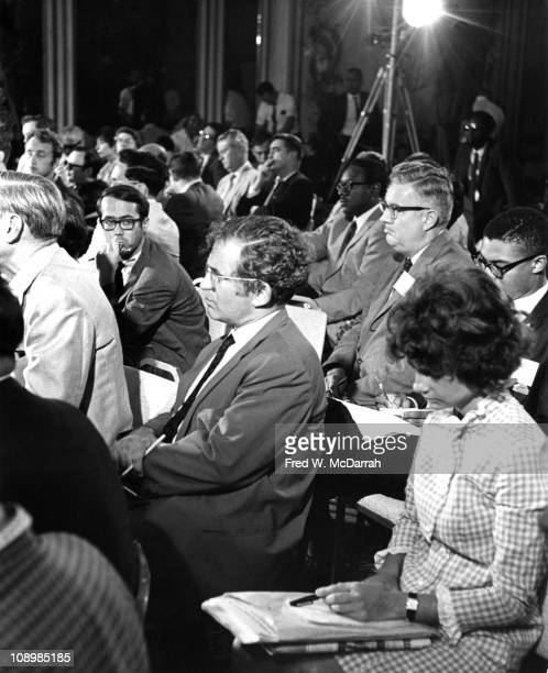 American author Norman Mailer sits in the audience at a press conference during the Republican National Convention Miami Florida August 6 1968