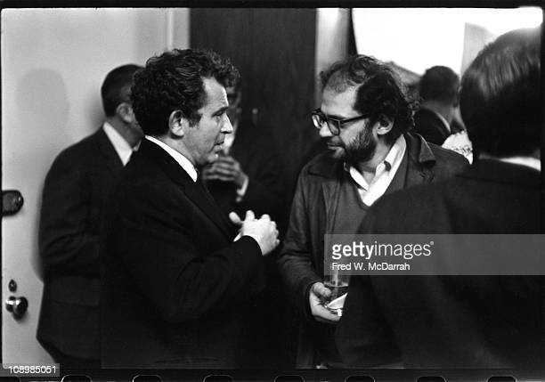 American author Norman Mailer speaks with Beat author and poet Allen Ginsberg at a Grove Press book party New York New York December 22 1964