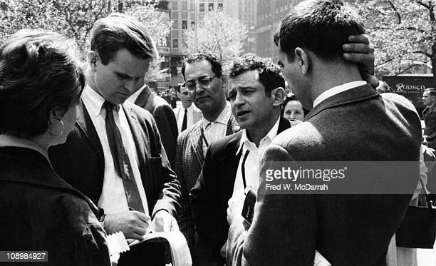 American author Norman Mailer speaks with reporters at a demonstration outside City Hall New York New York March 3 1960