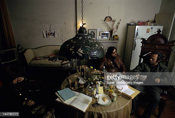 American author screenwriter Terry Southern and actor Rip Torn talk together in Torn's Chelsea apartment New York New York February 1973