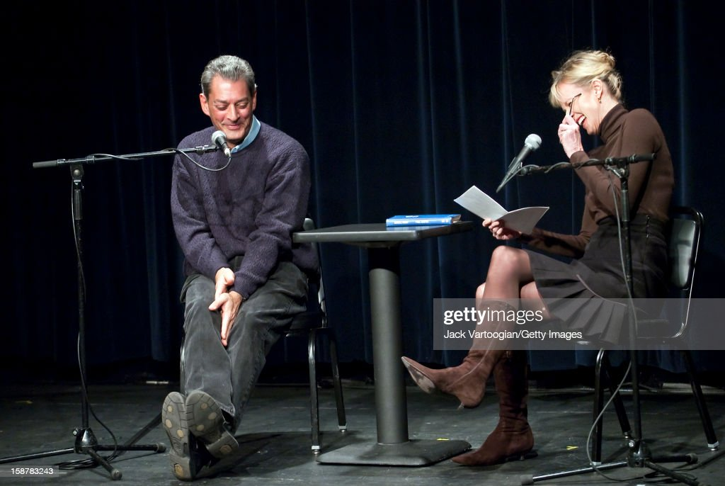 American author Siri Hustvedt (right) laughs as she interviews her husband, fellow author Paul Auster, at the Symphony Space Thalia Theater, New York, New York, January 19, 2009.
