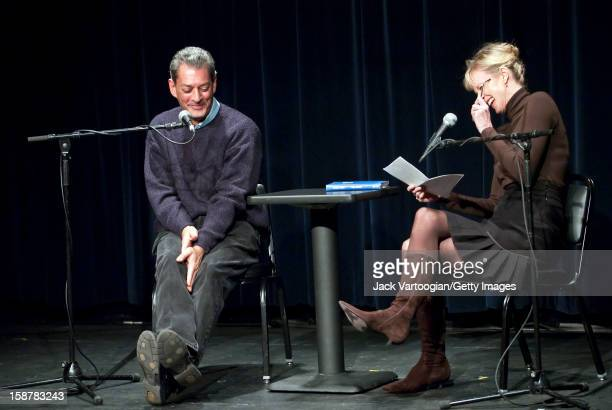 American author Siri Hustvedt laughs as she interviews her husband fellow author Paul Auster at the Symphony Space Thalia Theater New York New York...