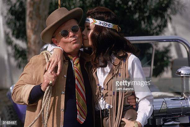 American author Truman Capote offers his cheek for a kiss from Viola Loewy in native American dress at Palm Springs California 1970