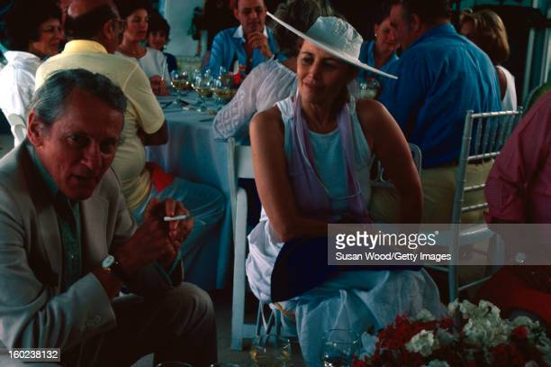 American author William Gaddis and socialite Muriel Oxenberg Murphy attend a Bastille Day party at Elizabeth Fondaras' home in East Hampton New York...