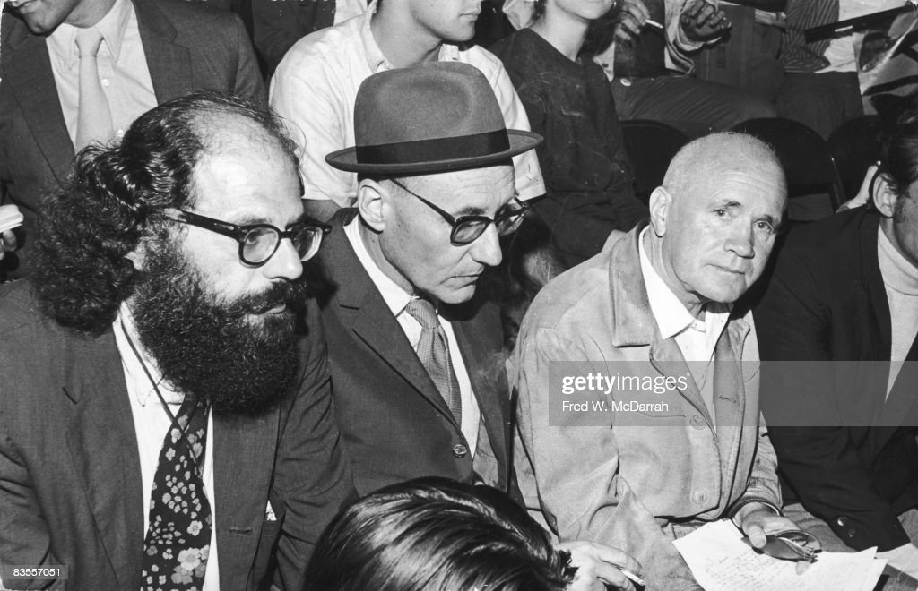 American authors Allen Ginsberg (1926 - 1997) (left) and William S. Burroughs (1914 - 1997) (second left), along with French author Jean Genet (1910 - 1986), cover the events of the Democratic National Covention for Esquire magazine, Chicago, Illinois, August 30, 1968. All three had had works published by Grove Press, whose publisher Dick Seaver is partially visible at extreme right.