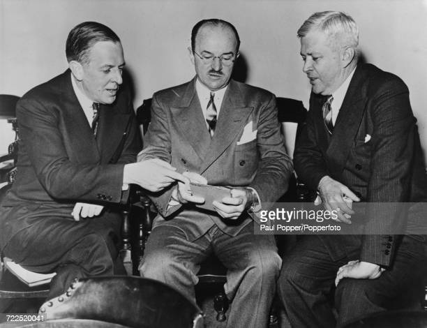 American auto industry executives from left Paul G Hoffman President of the Studebaker Corporation Ernest C Kanzler Automobile chief of the War...