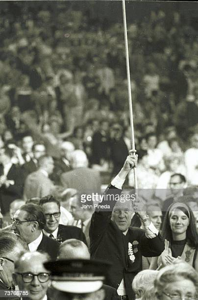 American automobile company executive and governor of Michigan George W Romney waves a pole amidst the crowd at the Republican National Convention...