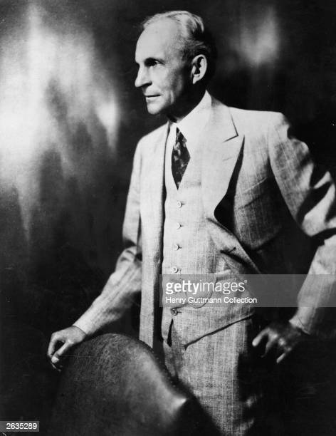 American automobile engineer and manufacturer Henry Ford who pioneered the modern 'assembly line' mass production techniques