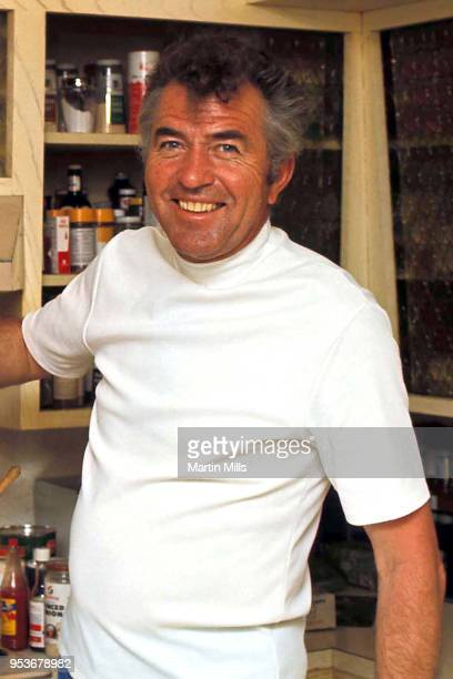American automotive designer, racing driver, and entrepreneur Carroll Shelby cooks Chili at home for his ex-wife Jeanne and daughter Sharon circa...