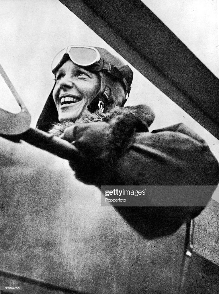 American aviation pioneer Miss Amelia Earhart 1898 - 1937, the first woman to fly across the Atlantic Ocean, pictured in her plane before a flight. : News Photo
