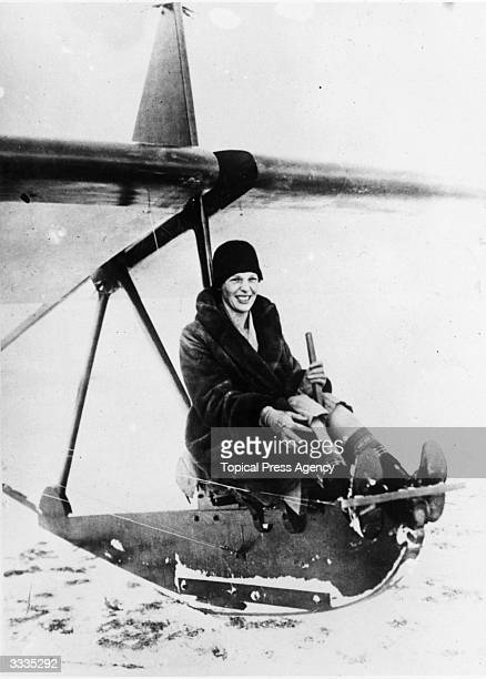 American aviator Amelia Earhart sits at the controls of an experimental glider before a flight at the Scripps estate 'Wildwood Farms,' Lake Orion,...