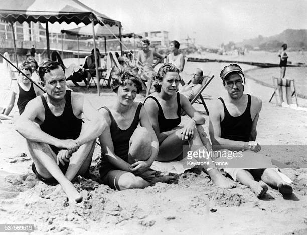 American aviator Amelia Earhart with her husband George P Putnam and British aviators Jim and Amy Mollison on the beach at Atlantic City New Jersey...
