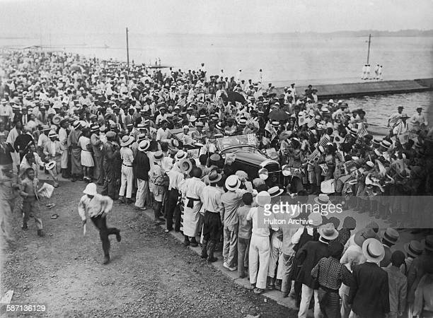 American aviator Charles Lindbergh and his wife Anne receive a warm public welcome upon their arrival at Kasumigaura, Japan, after a flight from the...