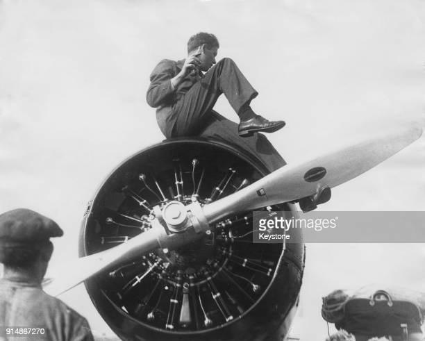 American aviator Charles Lindbergh on top of his aircraft in the south of Ireland, before leaving for the United States, 23rd October 1933.