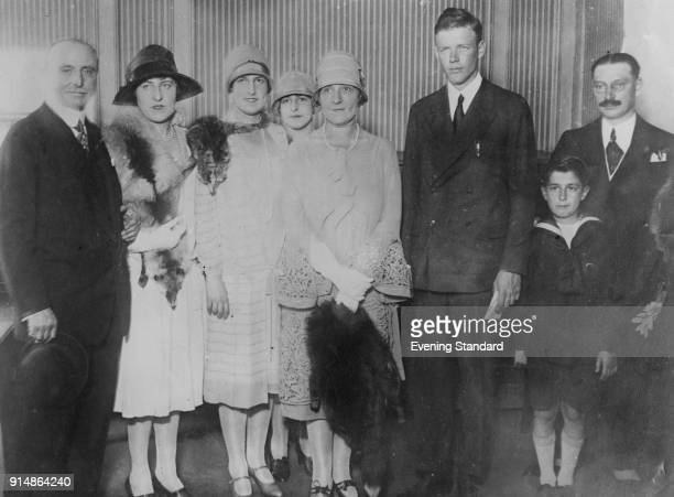 American aviator Charles Lindbergh poses with French aviator Louis Blériot and Blériot's son and three daughters, circa 1927. Blériot made the first...