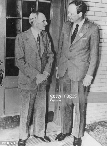 American aviator Charles Lindbergh poses with his new employer Henry Ford upon his arrival at Dearborn Michigan to take up his job at the Willow Run...