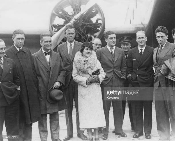 American aviator Charles Lindbergh poses with his wife Anne Morrow Lindbergh and various officials at Le Bourget Aerodrome in Paris, France, 31st...