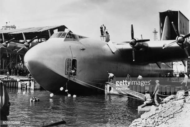 American aviator Howard Hughes atop his flying boat the Spruce Goose directing operations for the launch at Long Beach 6th November 1947 Here the...