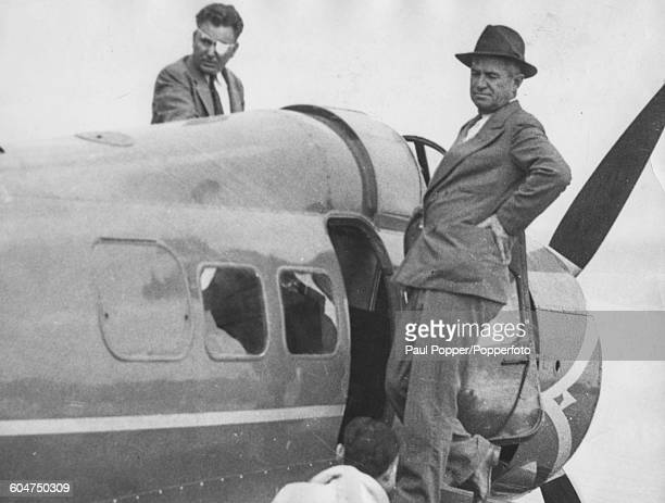 American aviator Wiley Post and American humorist Will Rogers pictured boarding their aircraft just prior to their fatal plane crash in Alaska 1935