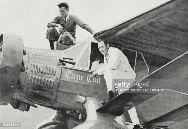 American aviators Russell Boardman and John Polando posing on the aircraft Cape Cod on the eve of the departure of their flight New YorkIstanbul that...