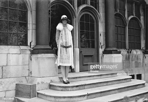 American aviatrix, Amelia Earhart at the house of the Hon. Mrs Guest in Park Lane, London, before leaving for the races at Ascot, 22nd June 1928.