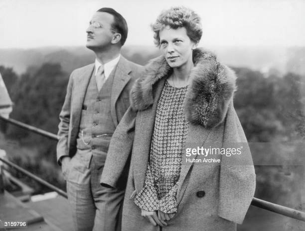 American aviatrix Amelia Earhart on the roof of the Hyde Park Hotel in London with Captain Hilton H Railey 20th June 1928 At Railey's suggestion...