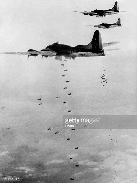 American B17 Flying Fortresses of the 8th US Air Force send their bombs plummeting toward rail installations at Bingen December 29 1944