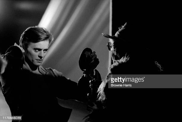 American ballet dancer Mikhail Baryshnikov backstage looking at mirror with makeup artist rehearsing the American Ballet Theatre's production of...