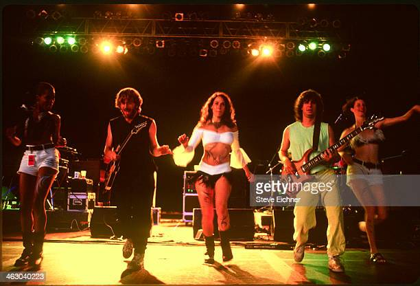 American band Phish perform with unidentified female dancers at the HORDE Festival Holmdale New Jersey July 11 1992 Pictured are musicians Trey...