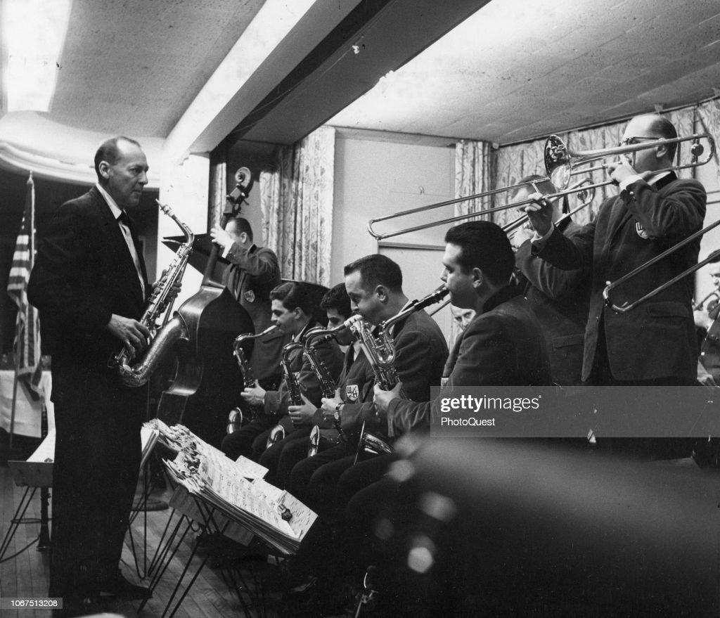 American bandleader Woody Herman holds a saxophone as he