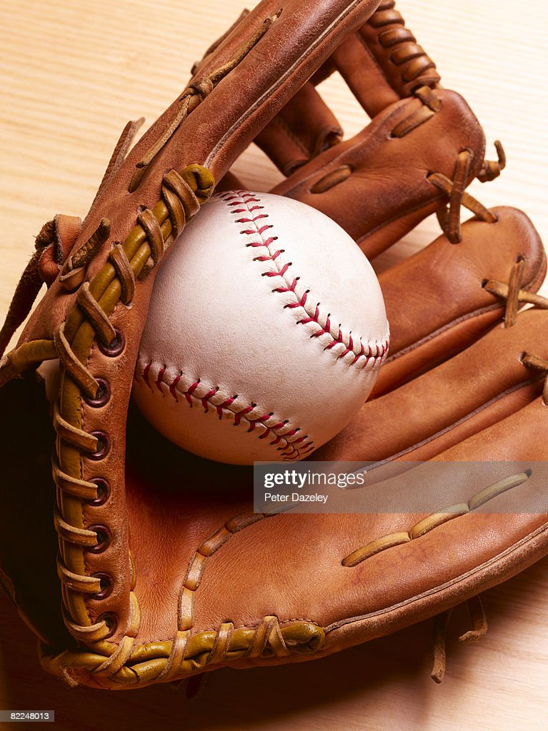 American Baseball in baseball glove mitt : Stock Photo