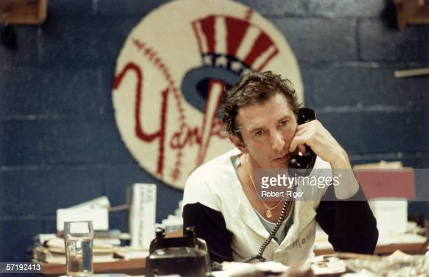 American baseball manager Billy Martin of the New York Yankees talks on the telephone at a cluttered desk 1976