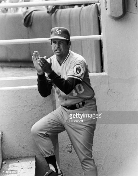 American baseball manager Dick Howser of the Kansas City Royals cheers from the dugout during a road game mid 1980s