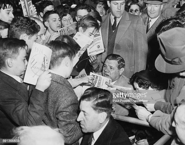 American baseball player Babe Ruth and his wife are mobbed by fans as he signs autographs at Yankee Stadium New York April 19th 1946