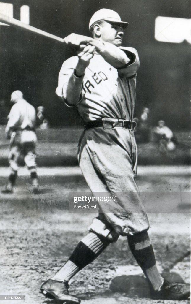 American baseball player Babe Ruth (1895 - 1948), of the Boston Red Sox, swings a baseball bat, 1918.