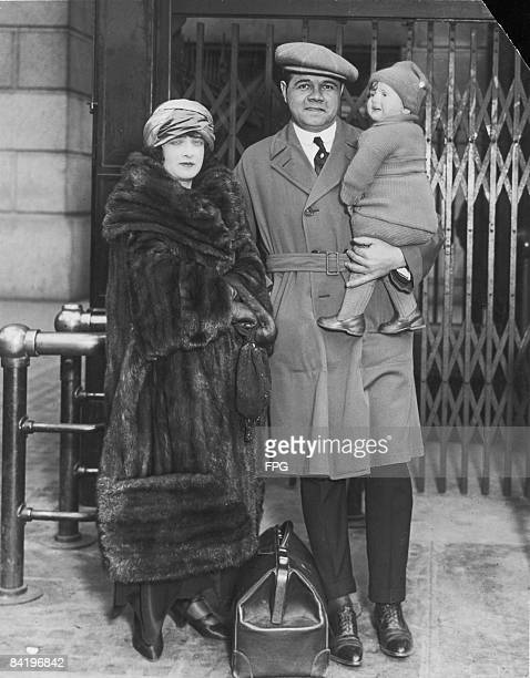 American baseball player Babe Ruth poses at Pennsylvania Station with his wife Helen Ruth and daughter Dorothy Ruth as he prepares to leave the...