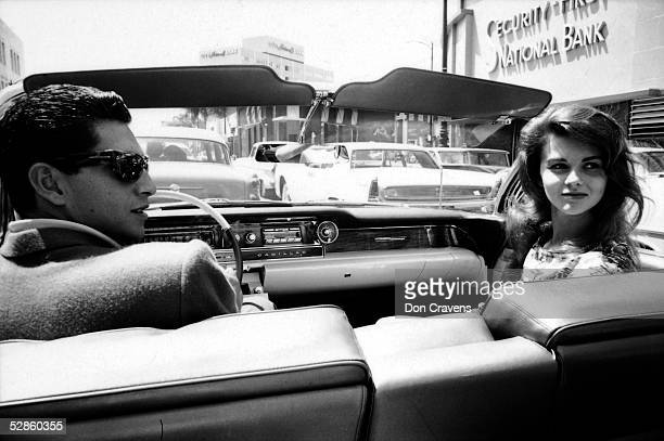 American baseball player Bo Belinsky pitcher for the Los Angeles Angels and his date Swedishborn actress AnnMargret look over their shoulders while...