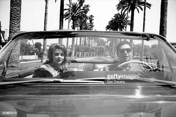 American baseball player Bo Belinsky pitcher for the Los Angeles Angels drives his date Swedishborn actress AnnMargret around in his new Cadillac...