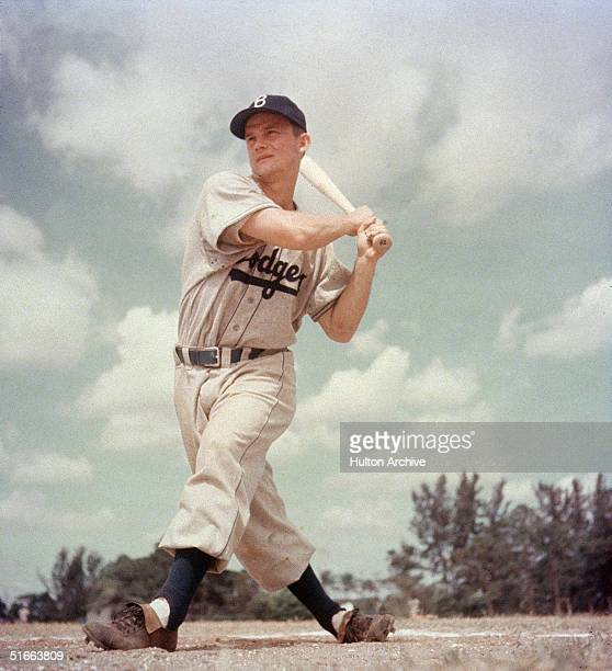American baseball player Don Zimmer in the uniform of the Brooklyn Dodgers swings at the plate mid 1950s