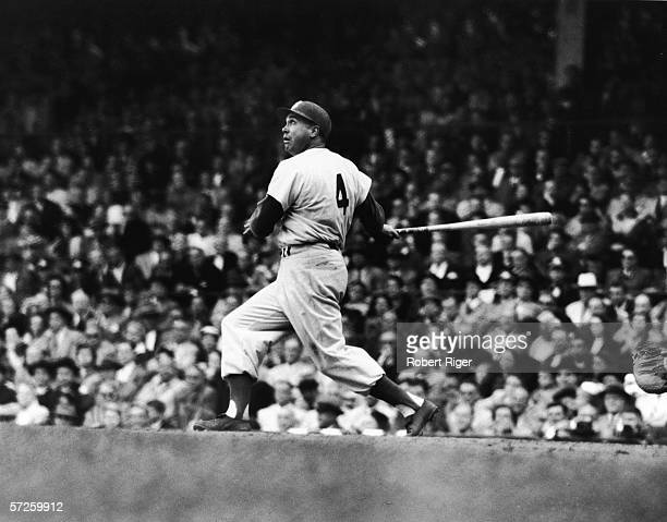 American baseball player Duke Snider follows the ball with his eyes after getting a hit during a game 1956